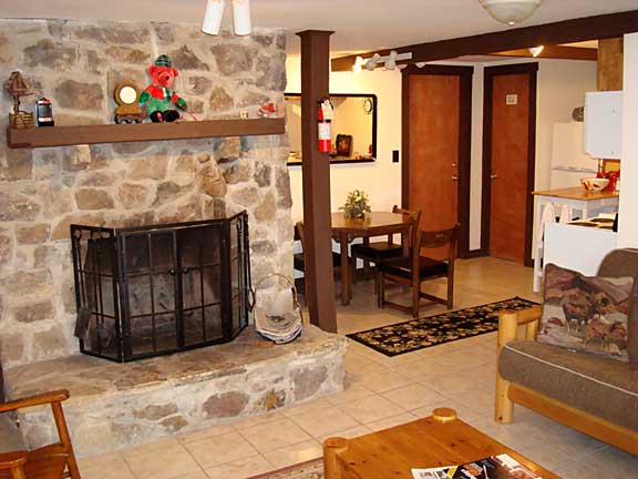 1st Floor Mountain View Suite - fireplace, dining area - at Sky Chalet Mountain Lodge