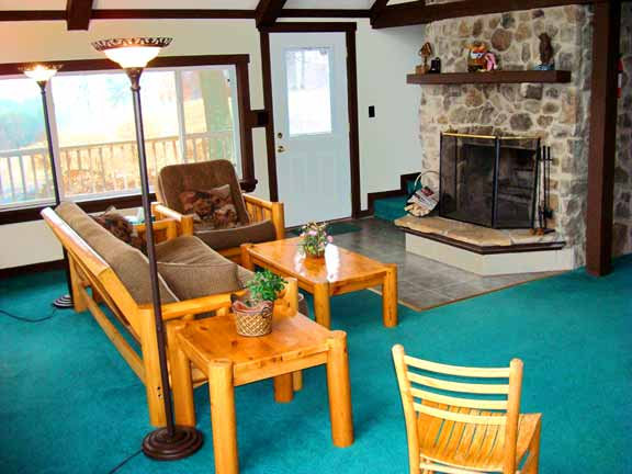2nd Floor Mountain View Suite - living area, stone fireplace - at Sky Chalet Mountain Lodge